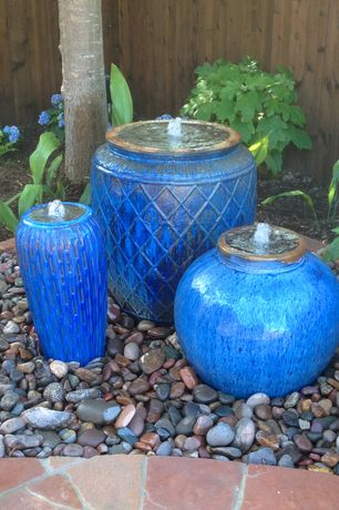 Mediterranean Landscape/Yard with Small ceramic planter, Large ceramic planter, Round ceramic planter