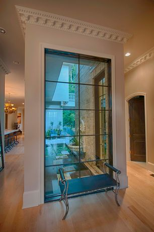 Traditional Hallway with specialty door, Crown molding, High ceiling, Hardwood floors
