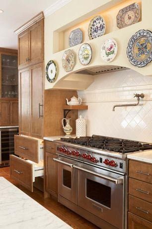 Country Kitchen with Wolf 8 burner gas range, Newport brass 948/20 wall mount pot and kettle filler, stainless steel