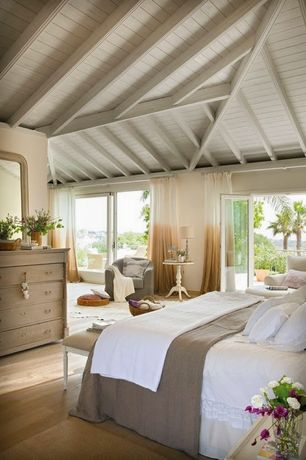Cottage Master Bedroom with Hardwood floors, Powell round white table, French doors, High ceiling, Exposed beam