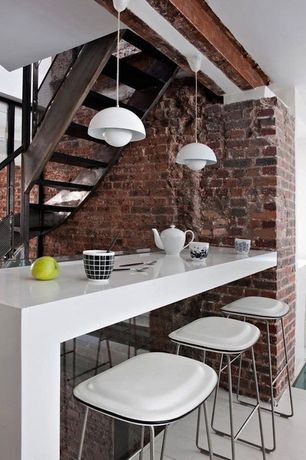 Contemporary Dining Room with picture window, Pendant light, Standard height, Concrete tile , interior brick, Exposed beam
