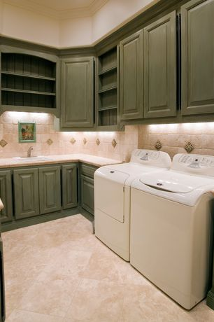 Country Laundry Room with Built-in bookshelf, laundry sink, Standard height, limestone floors, Crown molding, Drop-in sink