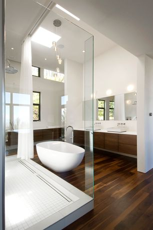 Modern Master Bathroom with Br111 macchiato-pecan engineered flooring, ET2 Orb 9 Light Pendant in Polished Chrome