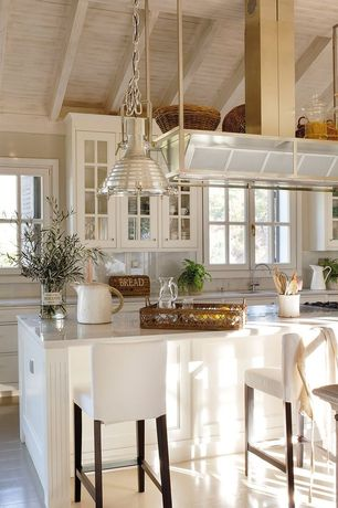 Cottage Kitchen with Hardwood floors, painted post, Kitchen island, Flush, electric cooktop, Simple marble counters, Paint