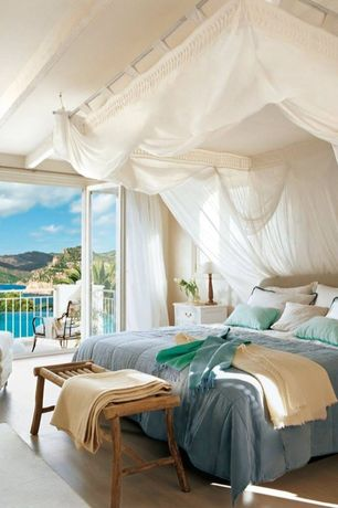 Tropical Master Bedroom with Glass folding door, Deck Railing, Exposed beam, Standard height, Paint 1, French doors