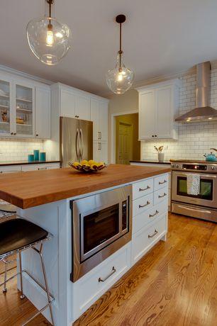 Contemporary Kitchen with Subway Tile, Soapstone counters, Breakfast bar, Pendant light, Glass panel, Kitchen island, Flush