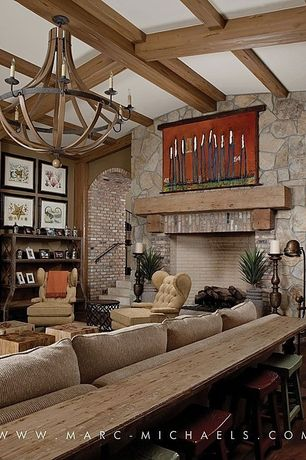 Rustic Living Room with High ceiling, Vintage tufted armchair, stone fireplace, Hardwood floors, Fireplace, Paint 2, Paint