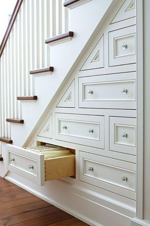 Traditional Staircase with Custom storage, Inset cabinet doors, Clear glass decagon ten sided drawer knobs, Cabinet finish