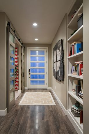 Contemporary Entryway with French doors, Hardwood floors, Built-in bookshelf, Trellis fez rug in neutral