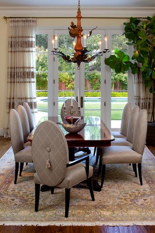 Traditional Dining Room with Crown molding, Hardwood floors, Chandelier, French doors