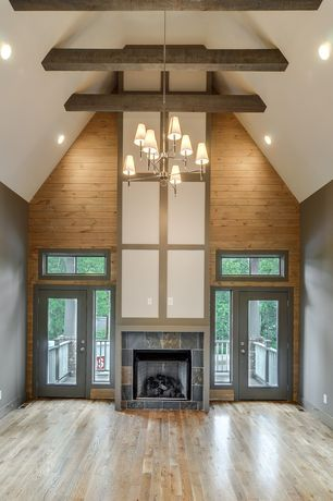 Contemporary Living Room with French doors, stone fireplace, Exposed beam, Transom window, High ceiling, Chandelier
