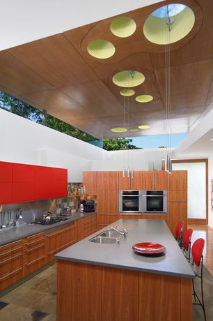 Modern Kitchen with Skylight, Stone Tile, Breakfast bar, 2 in. Solid Surface Countertop in Steel Grey, double wall oven