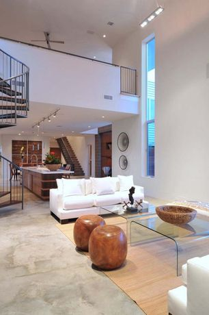 Great Room with can lights, Cb2 peekaboo clear coffee table, High ceiling, flush light, Loft, Spiral staircase, Chandelier