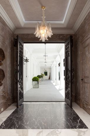 Traditional Entryway with Crown molding, Chandelier, complex marble tile floors, French doors, interior wallpaper