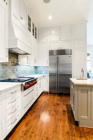 Contemporary Kitchen with Inset cabinets, Subway Tile, L-shaped, Kitchen island, Complex granite counters, Undermount sink