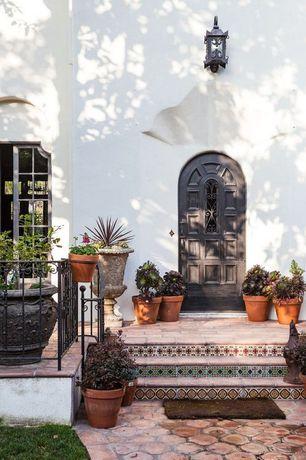 Mediterranean Front Door with Glass panel door, Paint, exterior terracotta tile floors, Deck Railing, Outdoor lantern