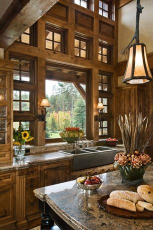 Rustic Kitchen with Inset cabinets, Farmhouse sink, Kitchen island, Glass panel, Ms International - Siena Beige Granite