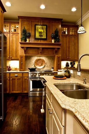 Craftsman Kitchen with Custom hood, European Cabinets, Flat panel cabinets, Crown molding, L-shaped, Simple Granite