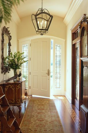 Traditional Entryway with Chandelier, Paint 1, Laminate floors, High ceiling, Crown molding, specialty door, Transom window
