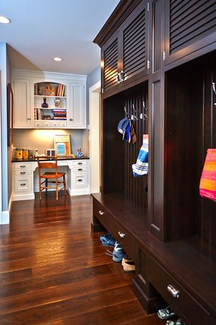 Craftsman Mud Room with Armstrong hardwood flooring in maple-cherry, Built-in bookshelf, Hardwood floors