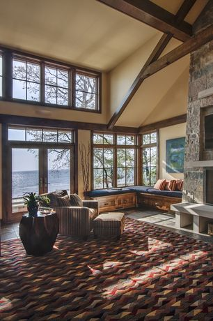Rustic Living Room with Greendale Home Fashions Outdoor Swing/Bench Cushion, Crown molding, slate floors, Exposed beam