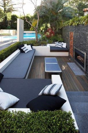 Contemporary Deck with Majestic sb series wood burning outdoor fireplace insert, Dune coffee table with pebbled glass, Fence