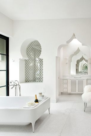 Contemporary Master Bathroom with Flat panel cabinets, Limestone, Wall sconce, Limestone counters, Master bathroom, Clawfoot