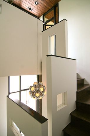 Contemporary Staircase with Hardwood floors, High ceiling, Chandelier