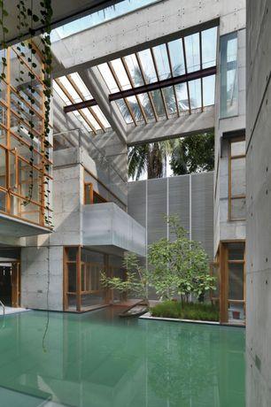 Modern Exterior of Home with Concrete wall, Atrium roof, Cantilever, Pool, Atrium