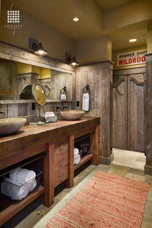 Country Full Bathroom with Stone vessel sink, Signature hardware dark grey river stone vessel sink, Tavern doors