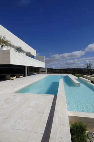 Modern Swimming Pool with exterior stone floors, Pathway
