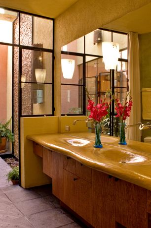 Eclectic Master Bathroom with Undermount sink, Wood counters, Flush, European Cabinets, Glass panel door, Double sink
