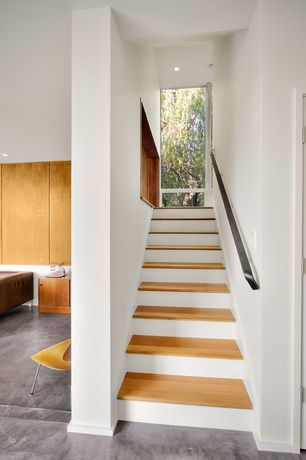 Contemporary Staircase with curved staircase, Standard height, can lights, Hardwood floors, picture window