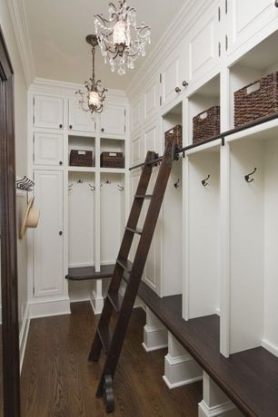 Traditional Entryway with Chandelier, High ceiling, Built-in bookshelf, Crown molding, Hardwood floors