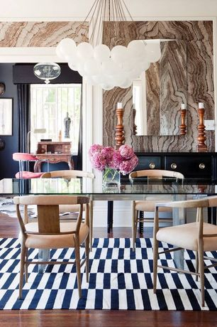 Eclectic Dining Room with Chandelier, Laminate floors, interior wallpaper