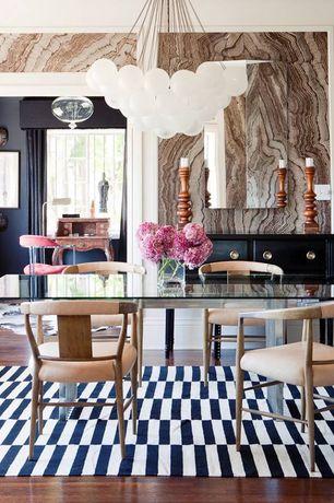 Eclectic Dining Room with flat door, Chandelier, Laminate floors, interior wallpaper, Standard height
