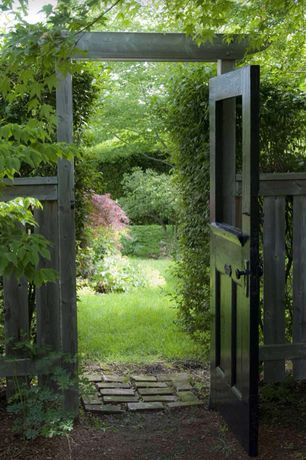Cottage Landscape/Yard with Vintage Door, Fence, Pathway, Gate, Arbor, Exterior Door, Wood fence, Brick pathway