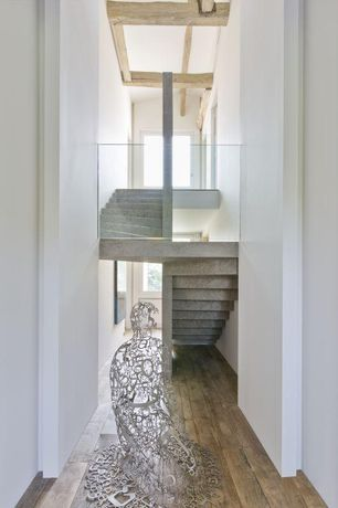 Modern Staircase with Hardwood floors, Columns, Exposed beam, curved staircase, Casement, High ceiling