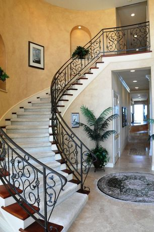 Mediterranean Staircase with simple marble floors, Cathedral ceiling