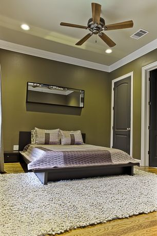 Contemporary Guest Bedroom with Hardwood floors, Emerson electric 52-in builder ceiling fan, Paint 2, six panel door, Carpet