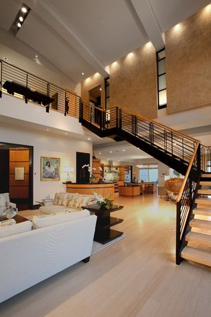 Contemporary Staircase with can lights, Hardwood floors, Exposed beam, Cable railing, Curved ceiling, Metal staircase, Paint