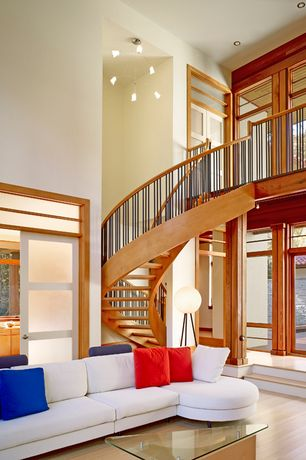 Contemporary Staircase with Chandelier, High ceiling, Hardwood floors, Spiral staircase