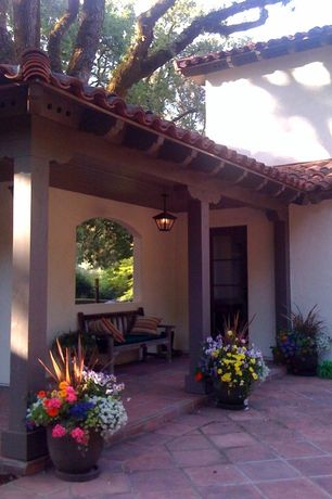 Mediterranean Porch with exterior terracotta tile floors, Screened porch, Glass panel door, exterior tile floors