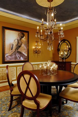 Traditional Dining Room with Hardwood floors, Standard height, Wainscotting, Chandelier, Crown molding