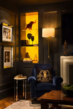 Living Room with Built-in bookshelf, Hardwood floors, Standard height, Wall sconce, Paint