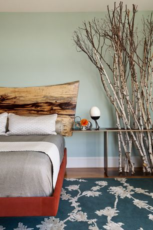 Contemporary Guest Bedroom with Live edge wood headboard, Hardwood floors