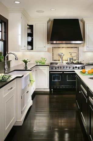 Eclectic Kitchen with Corian Antarctica, drop-in sink, Black lacquer cabinets, Flat panel cabinets, double oven range, Galley