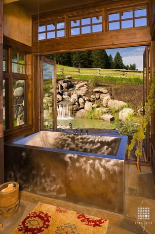 Country Master Bathroom with Paint, French doors, Metal bathtub, Casement, stone tile floors, Clerestory windows, Bathtub