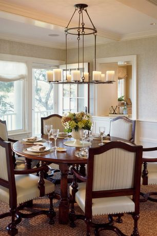 Traditional Dining Room with French doors, Crown molding, Exposed beam, picture window, can lights, Carpet, Standard height