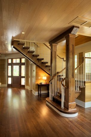 Craftsman Staircase with Crown molding, Hardwood floors, Columns, picture window, curved staircase, Exposed beam